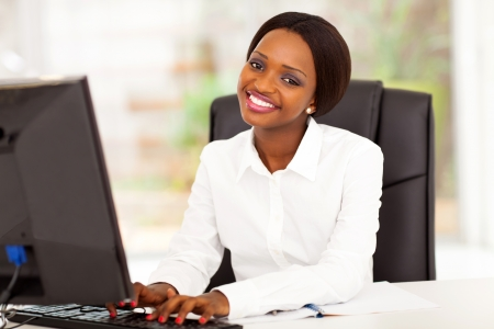 african american businesswoman: young african american businesswoman working on computer