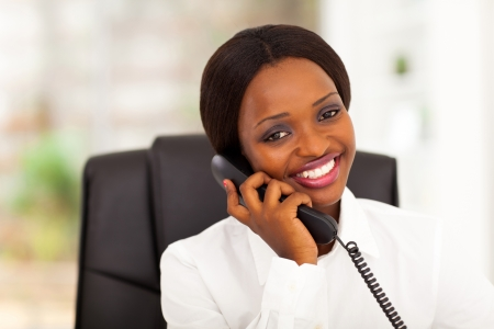 business woman phone: pretty female african office worker talking on phone