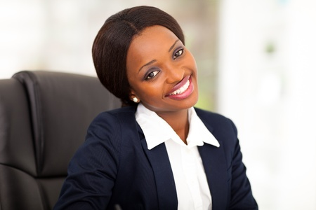 navy blue suit: cute african american corporate worker in office Stock Photo