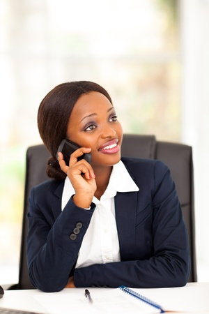 pretty african american office worker talking on cell phone Stock Photo - 17457279