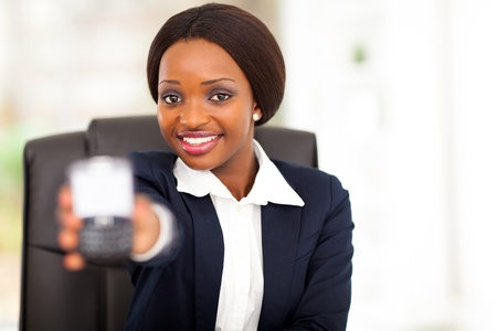 pretty african american businesswoman showing message on smart phone photo