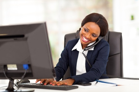 business woman phone: beautiful young african american businesswoman working in office