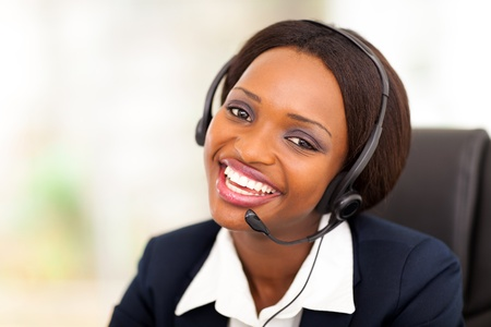 navy blue suit: happy african american call center operator with headphones