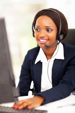 call center office: african american online support operator using computer