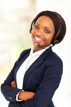call center female: young african american business call center operator Stock Photo