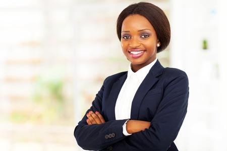 pretty african american businesswoman half length portrait in office photo
