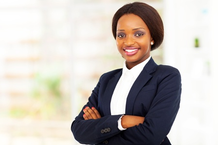 navy blue suit: pretty african american businesswoman half length portrait in office