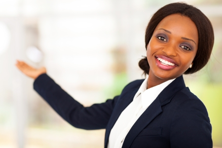 navy blue suit: cheerful african american businesswoman presenting