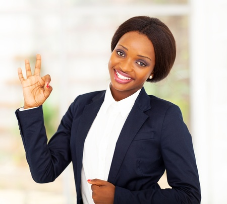 pretty african american businesswoman giving ok hand sign photo