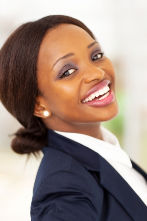 navy blue suit: happy african american corporate worker closeup