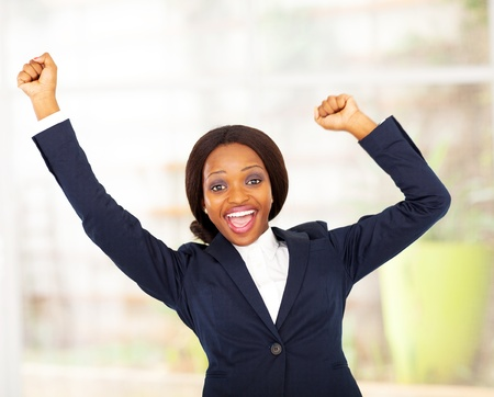 cheerful african american businesswoman in office  photo