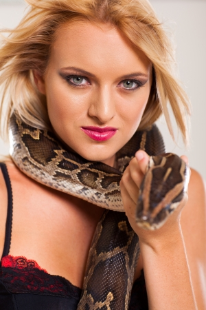 young blonde woman holding serpent photo