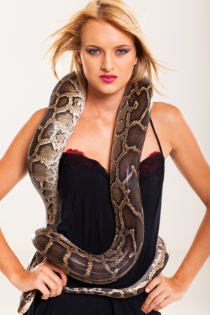 sexy blonde woman posing with python photo
