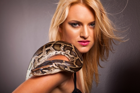 attractive young woman with python on her shoulder photo