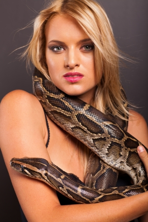 attractive young woman with python around her neck photo