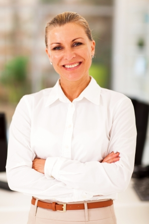happy senior businesswoman in modern office photo