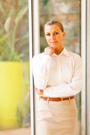half dressed: elegant female senior corporate worker in office Stock Photo