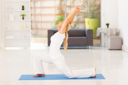 adorable home: senior woman doing exercise at home