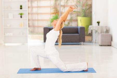 senior yoga: senior woman doing exercise at home