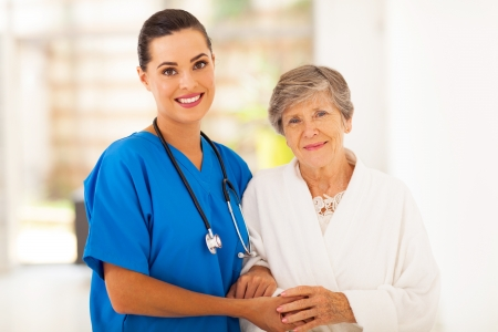 home health care: senior woman and caring young nurse