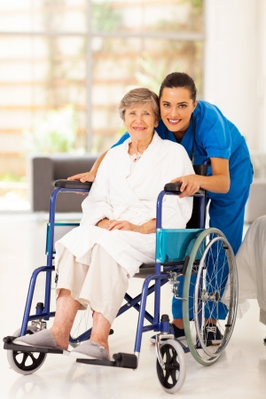 elderly woman and young caregiver at home photo