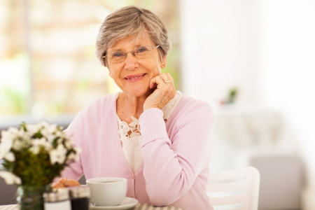 seniors homes: elegant senior woman having tea