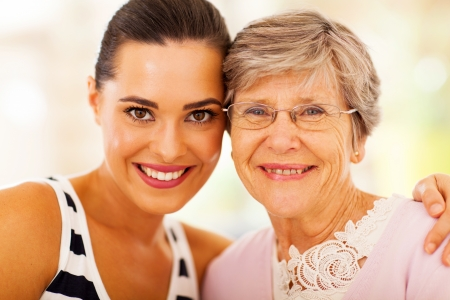 granddaughter: happy woman and senior mother closeup portrait Stock Photo