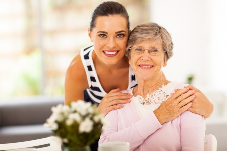 granddaughter: pretty woman and senior mother at home Stock Photo