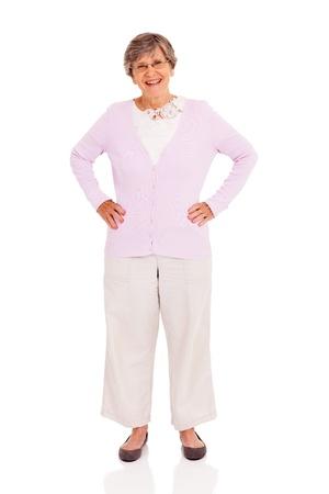 adult 80s: elderly woman full length portrait on white background Stock Photo
