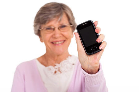 old cell phone: senior woman showing message on cell phone