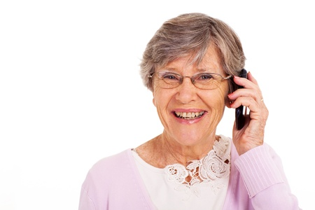 talking telephone: happy senior woman talking on cell phone isolated on white