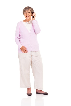 happy elderly woman talking on mobile phone isolated on white photo