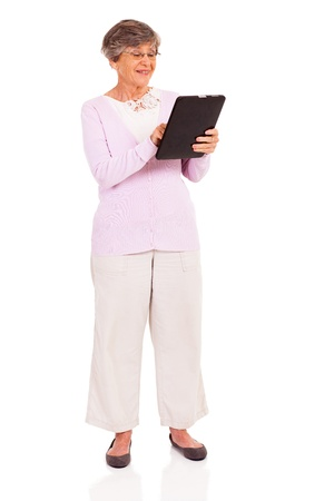 happy senior woman using tablet computer isolated on white photo