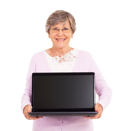 senior woman holding a laptop computer isolated on white Stock Photo - 17591228