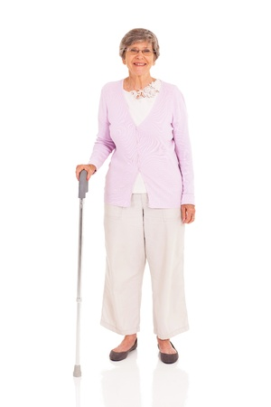 senior woman with walking cane isolated on white background photo