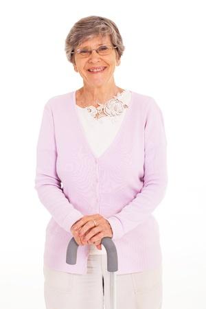 walking stick: happy elderly lady with walking cane isolated on white