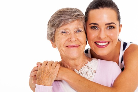 mum and daughter: happy senior mother and adult daughter closeup portrait on white