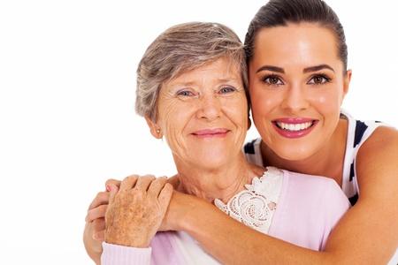 mere et fille: heureuse m�re senior et adulte closeup portrait fille sur blanc Banque d'images