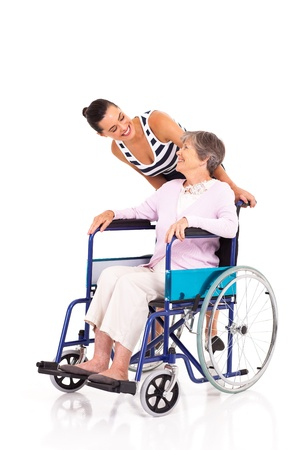 grandkids: caring daughter talking to disabled senior mother isolated on white