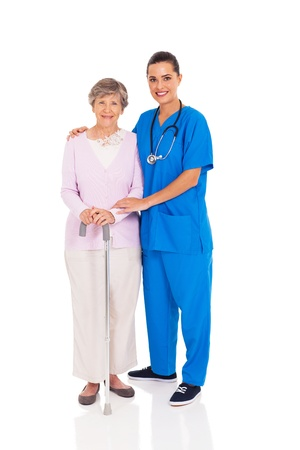 patient care: beautiful young nurse and senior woman isolated on white