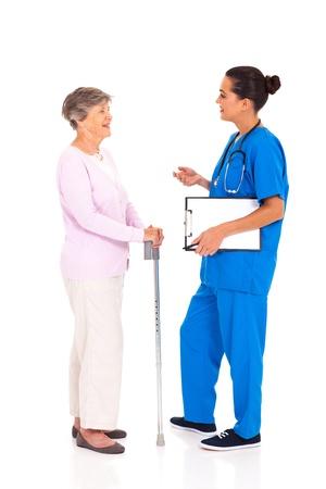 medical nurse talking to senior woman isolated on white Stock Photo - 17591206