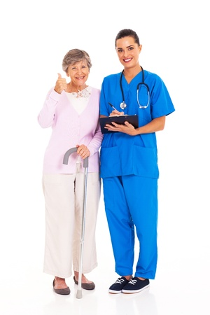 senior woman giving thumb up to medical service with nurse Stock Photo - 17591198