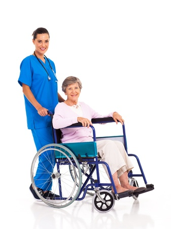 wheelchair: young nurse and senior patient isolated on white