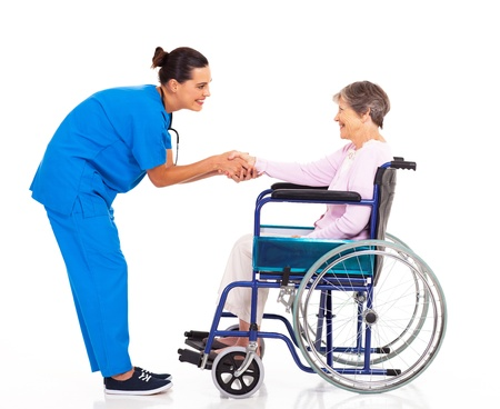 friendly nurse greeting disabled senior patient photo