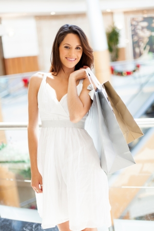 attractive young woman carrying shopping bags in mall Stock Photo - 17594874