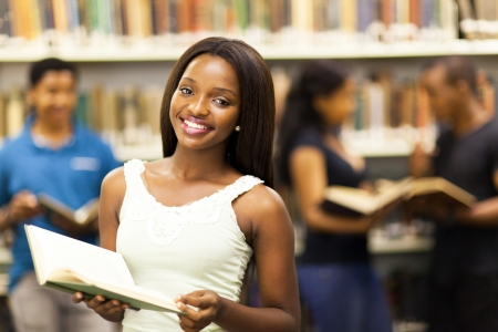 college campus: beautiful african american college girl in library