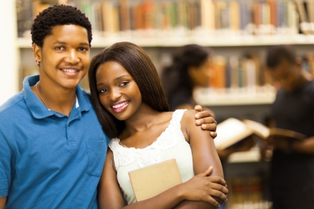 happy african college couple in library Stock Photo - 17718434