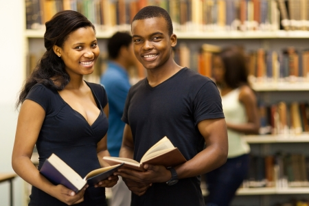 african american: group of african american university students in library