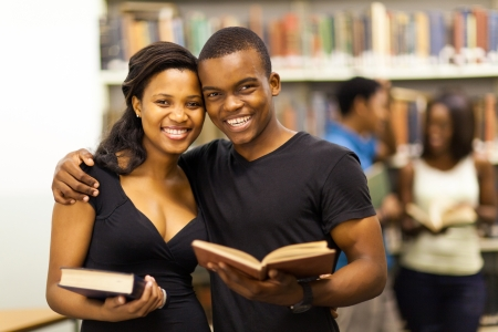 librarian: happy african american university couple in library Stock Photo