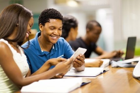 student university: happy african college students using tablet computer together